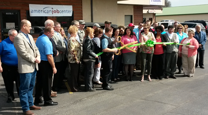 Photograph of a ribbon cutting ceremony at the American job center