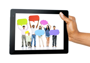 Hand-Holding-Digital-Tablet-with-People-and-Speech-Bubbles